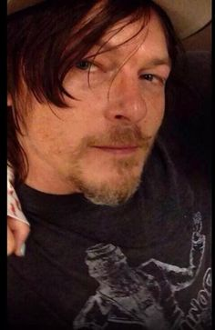 """Is it normal that I see part of some chick in these photos of Norman and get really miffed and suddenly want to know, """"who the hell is that?!?"""""""