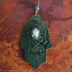 This beautiful one-of-a-kind Hamsa was formed using high-fire white earthenware clay, in hand-built method. Using my various stamps and tools, I cut and textured this unique hamsa shape, then fired it to bisque. After taking it out of the kiln, I glazed it with lead-free blue glaze and high fired it again in my kiln at my studio. Ceramic hamsas by KerenOrHandmade on Etsy