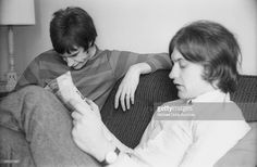 Ray Davies and Dave Davies of the rock group 'The Kinks' relax in their hotel room in August 1965 in New York, New York.