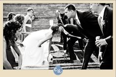 How to Plan A Wedding Around Football - In this picture, the wedding party is lined up on the line of scrimage, guys against girls in full formal wedding attire!
