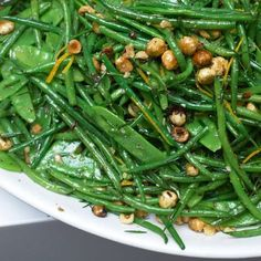 """French beans and mangetout with hazelnut and orange l (""""Mangetout"""" – meaning """"eat it all"""" – refers to snow or snap peas.) French beans and mangetout with hazelnut and orange l (""""Mangetout"""" – meaning """"eat it all"""" – refers to snow or snap peas. Vegetable Sides, Vegetable Recipes, Vegetarian Recipes, Cooking Recipes, Healthy Recipes, Vegetable Salad, Ottolenghi Recipes, Yotam Ottolenghi, Ottolenghi Cookbook"""