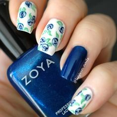 One more floral inspired dark blue nail art design. The nails are in metallic blue shades as well as white. On the white polish the blue flowers are painted and they look absolutely stunning.