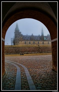 Krongborg (Hamlet's castle), Denmark.  Only problem is that this castle was built in the 16th century, and Hamlet takes place in the Dark Ages, during the time of the Danelaw.  I guess Shakespeare wasn't concerned with the details.