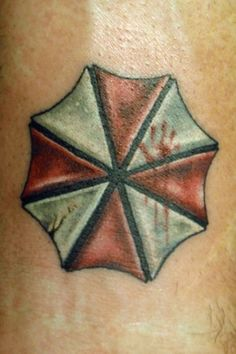 umbrella corporation symbol from Resident Evil! LOVE the bloody hand print. Future Tattoos, Love Tattoos, Beautiful Tattoos, Body Art Tattoos, I Tattoo, Tatoos, Resident Evil, Gamer Tattoos, Evil Tattoos