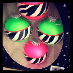 My Christmas tree theme is zebra print and purple, it would be fun to find some zebra ribbon and plain round purple ornaments and make some of these, or instead of the ribbon you could just paint the zebra print