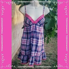 Victoria's Secret Babydoll Plaid Nightie VS ruffle hem flannel plaid nightie, size medium. Purple, pink and white with silver threading and pink lace trim. Adjustable straps. Smoke free home, make offer or bundle for discount!   #Victoriassecret #VSsecret #plaidnightie #plaid #rufflednightie #VS #babydoll Victoria's Secret Intimates & Sleepwear Chemises & Slips