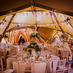 A magical winter wedding with a vicar playing the saxophone, an enchanting tipi reception full of rich red blooms and rustic DIY decor.