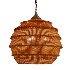 The Armadillo Rattan Hanging Light is hand-woven by skilled weavers at Soane's Leicestershire rattan workshop, to resemble the leathery armour of an Armadillo.