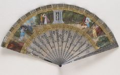 Cut steel fan embroidered with cut steel sequins of varied shapes and sizes, with cut out gilt motifs and figures in Classical dress at the temple of the goddess Diana. French, c. 1810. Waterloo Life & Times Exhibition | The Fan Museum, Greenwich
