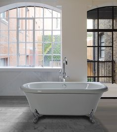 Classic, traditional clawfoot tub. Chrome and Brushed Nickel feet standard. White and other powder-coated finishes available. See also drop-in tub model #203.