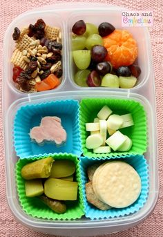 homemade trail mix, fruit, cheese and ham cubes, rice crackers