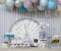 Backdrops: like the use of silver metallic ribbon, both hanging and on table...balloons could go either way, might be too cheesy, but could be nice if done in extra large oversize silver, perhaps as dessert auction background...