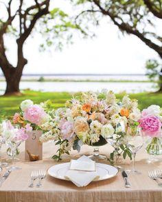 pretty spring blooms + pretty brass bird serves as table number by @Kristin Newman Designs. Photography by: Elisabeth Millay #wedding #springwedding #summerwedding