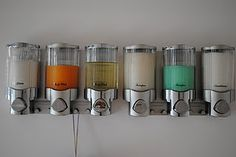Easy way to organize and declutter your shower.  (I like this idea, so I'm pinning it.  The despenser is on Amazon.com and priced at a little over $30 for one...this is two.)  I would try to catch this on a sale or shop eBay maybe.