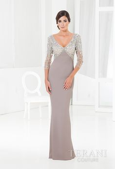 Sleek and sophisticated jersey empire waist gown with a v-neck and rhinestone embellishments covering the bust and 3/4 sleeves