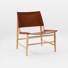 Leather Sling Chair, might be an option, no arms, but would look good in the space