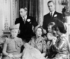 From left: Queen Mary, King George VI, Princess Elizabeth (later Queen Elizabeth II) holding Princess Anne, Duke of Edinburgh (Prince Philip) and Queen Elizabeth ('Queen Mum') holding Prince Charles