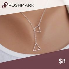 Silver Double Triangle Geometric Necklace Brand new boutique item! 💕   Bundle 2 or more items for 15% off OR 6 or more items for 25% off!!  Please make an offer using the offer button instead of comment section.   Happy to answer any additional questions ☺️  Thank you so much for shopping my closet!! ❤️ Raleigh Runway Jewelry Necklaces