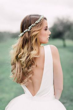 Boho bride with curls and flower crown | Kate Drennan Photography | See more: http://theweddingplaybook.com/romantic-bohemian-wedding-inspiration/