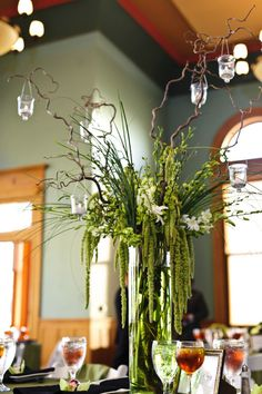 Lights on the curly willow branches for the pumpkin/gourd hurricanes on the food table.