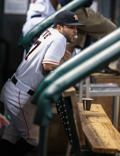 CrowdCam Hot Shot: Houston Astros second baseman Jose Altuve stands in the dugout before a game against the Cincinnati Reds at Minute Maid Park. Photo by Troy Taormina