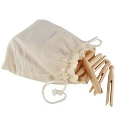 """Hardy """"old-fashioned"""" clothes pegs made from sustainably harvested wood and offered 50 to a pouch."""