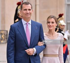 King Felipe VI and Queen Letizia of Spain leave the Elysee palace after their meeting French President Francois Hollande (not seen) on July 22, 2014 in Paris, France. King and the Queen of Spain pay their first official visit to France.