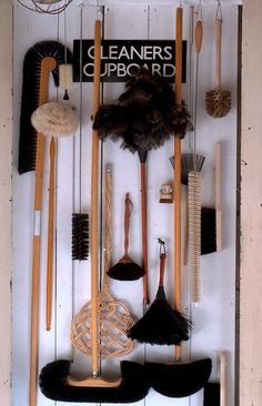 The brooms and brushes range from ostrich feather dusters and goat's-hair parquet-floor brooms to copper-wire barbecue scrubbers and horsehair cobweb brooms.