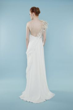 Look stunning on your wedding day in this gorgeous one shouldered sheath gown embellished with Swarovski crystals and 3d flowers. | Style Name: Grecian | Brand: Master/slave | Made to order | #weddingdress #bridalgown #gownbridal #weddinggown #bridaldress #wedding #sheath #offtheshoulder #oneshoulder #drape #grecian #greciangown