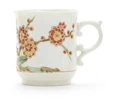An early Worcester coffee cup, circa 1752-3  slightly-waisted bell shape with a scroll handle with a pronounced thumbrest, painted in the Kakiemon taste with branches of flowering prunus, the blossom in red and yellow, growing from a gnarled root with fleshy leaves in between, a single thin red line forming a horizon just above the base of the cup, 6.5cm high (rim chips, oxidisation to the blue enamel £812