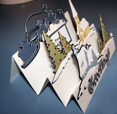 Folded card    This one created with the Cricut Christmas cartridge. Another idea (a good way to use older/used cards)