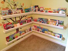Rain gutter book shelf. Took $86 and three hours but created a cute nook.