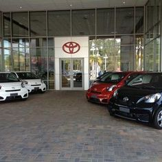 """~ The entrance -- the new Scion iQs all lined up like people. It's funny, when you're around these cars all day, they almost take on a personality. With head-light eyes and smiling grills -- they seem to be """"happy"""" all the time."""
