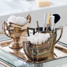 Vintage silver sugar and creamer set as bathroom storage