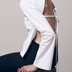 White shirt with open back; contemporary fashion details // Protagonist