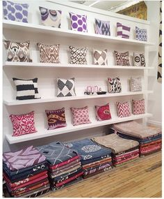 Great shot from designer Amber Lewis, of the Ikat Pillow wall at the Madeline Weinrib atelier.