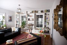Built in shelving surrounding windows In the Hudson Valley, Room for Work and Play | Design*Sponge.