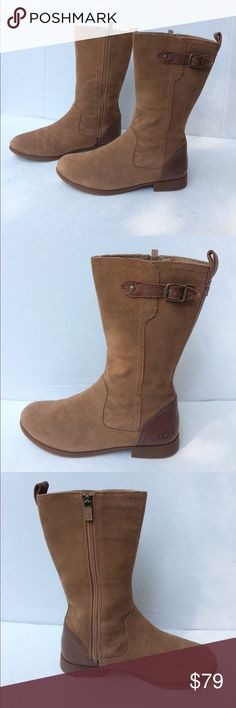 """UGG Women's Shearling Suede Mid Calf Boots This is a gorgeous pair of shearling Suede mid calf boots. Tan suede with brown leather at the heel. They have a leather strip running up the back with a pull tad and An outside decorative leather strap and buckle. They zip from the inside. The lining is satin signature. They measure 11"""" tall with 1"""" heels. These boots are in phenomenal preowned condition UGG Shoes Ankle Boots & Booties"""