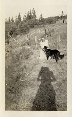 woman with dog.  nice long shadow.