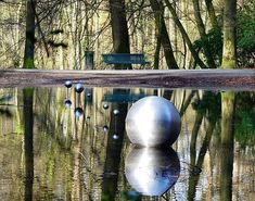 Have you ever seen this artwork in Sonsbeekpark? And always wanted to know what it is? Here goes:  The official name of the artwork is Skies Captured and the artist is called Henrietta Lehtonen. The stainless steel scale model has been standing in the water of the so-called Cold Pond since 2001. On closer inspection it is not a scale model with regard to the distances because in reality they are much larger. But the mutual dimensions seem to be quite right.  From left to right we see the Sun…