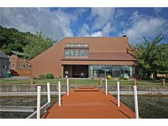 """RARE WATERFRONT!!! THE """"CROWN JEWEL"""" OF IRONDEQUOIT BAY! ON A SECLUDED POINT WITH WATER VIEWS TO THE SOUTH AND NORTH TO LAKE ONTARIO! 210' OF WATERFRONT WITH OPEN FLOOR PLAN! AMAZING ALL GLASS GREAT ROOM & FIRST FLOOR MASTER BEDROOM TO TAKE IN THE GORGEOUS VIEWS! ARCHITECT DESIGNED 4 BEDROOM, 2.5 BATHROOMS! BOAT HOIST FOR A 24' BOAT & DOCK INCLUDED! + IN-GROUND HEATED POOL & HOT TUB! POSSIBLE PARTY DECK AND BALCONY ON ROOF OF PROPERTY! LAKE ONTARIO ACCESS!! 190 Schnackel Dr Irondequoit, NY…"""