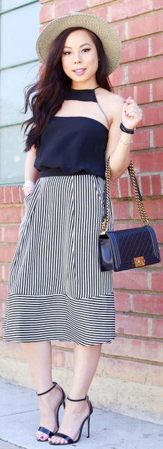 You'll be a style expert this spring with these 8 simple rules of wearing a midi skirt. Pink, gray, lace, tulle, striped, or plaid—no matter which you choose, tips like balancing your look and playing with proportions will help you top the best-dressed lists. So the next time you go out, show off your natural radiance and rock a midi skirt!