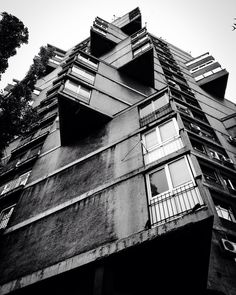 """The super-cool """"Toblerone-Building"""" built in 1963 in eastern part of #Beograd.  The brutalism of this kind never fails to fascinate me!  #architecture #archilovers #blackandwhite #RistaSekerinski #Belgrade #Serbia #brutalism #brutalistarchitecture #europe #balkans #balkan #visitbalkans #photography #karaburma #Toblerone #concrete #1963 #modern #iphone by gentibehramaj"""