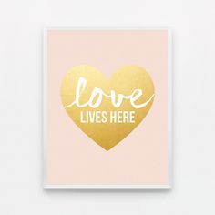 LOVE LIVES HERE - BLUSH PINK AND GOLD  8 x 10 inches.  *IMPORTANT NOTE* The gold pictured in this print is not gold foil or gold leaf - it is a printed image of gold. This method ensures that your print will be more environmentally friendly, long lasting and won't fade - and there are no worries about the gold flaking off. This does mean that the gold will not have the same dimension as foil or leaf would - it will not shimmer and change colors in the light.