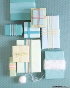 Yarn-Embellished Gift Wrap | Martha Stewart Living - Give holiday gifts unexpected panache by using leftover yarn in place of ribbon. Wind cotton or wool yarn around presents (solid-color paper looks best) a few times for thin stripes or several times more for thick ones.