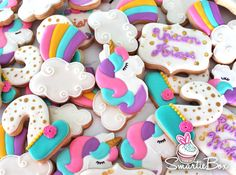 Rianbow unicorn cookies in pink, purple, turquoise and yellow - SmartieBox Cake Studio