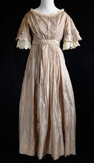 1830's Striped Dress.. The fine, lightweight silk striped bodice is gathered and pleated in the front and back, is lined with muslin, and buttons in the back. There is a hook and eye closure in the back of the bodice at the waistband, which is under the bust line and above the natural waist.