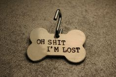 """Pet ID Tag - """"Oh SHIT, I'M LOST"""" - bone shape - with your pet's name and your phone number on the back. on Etsy, $19.00"""