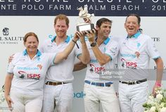 Melissa Ganzi, Prince Harry, Malcolm Borwick and Bob Jornayvaz are seen during the awards ceremony at the Sentebale Royal Salute Polo Cup on May 4, 2016 in Wellington, Florida.