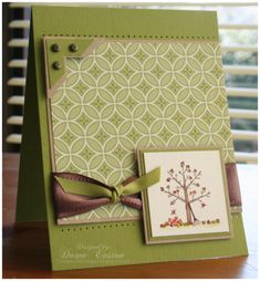 By Dawn Easton (TreasureOiler at Splitcoaststampers). Stamp tree & then color with markers or color right on the stamp itself before stamping. Cut mats to frame. Use designer paper for the big mat. Add ribbon and brads.